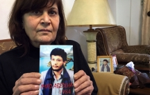 Samia Abdullah holds up a picture of her brother Emad who disappeared in 1984 when he was 20 years old. His family thinks he's still alive in a Syrian prison.