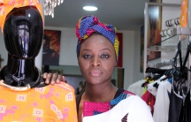 """Khady Sy Savane in her boutique, Mia Dreams, in the Goutte D'Or section of Paris. Many of her designs incorporate African wax print fabrics with names like """"your foot my foot."""""""