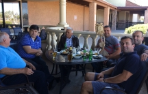 A group of Serbian-speaking men have a leisurely lunch at the Q2 Café in Phoenix. The café, run by a Bosnian Serb refugee, aims to attract patrons from all parts of the former Yugoslavia.