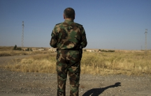 """The """"Colonel,"""" 48, looks out at a small village outside Kirkuk littered with homemade bombs from ISIS militants. He team has to clear away IEDs set by ISIS militants, but they have little equipment to do the job."""
