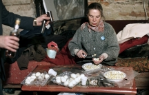 Egg salad for Passover in Drohobych, Ukraine. Loli Kantor remembers this method of cutting an egg in the palm of your hand from her youth. It's part of the Jewish life that she documented in Ukraine.