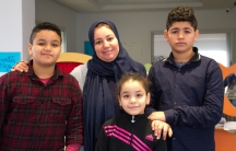 Fatima Elahmer and her three children, Mohamed, Anoud, and Ali. They've been living in Tunis since last summer.