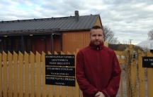 """Jukka Tiihonen served the last few years of his sentence for murder at this open prison on Suomenlinna Island. The yellow fence, with a sign saying, """"Labor Colony"""" in Finnish, Swedish, English, and Russian, separates the prison from a neighborhood."""