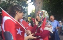 Two women discuss Turkish politics during a joint rally in Istanbul between the Islamist and secularist parties shortly after the attempted coup in late July.