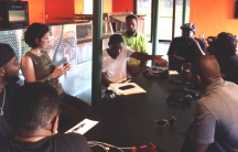 Kelly Orians facilitates a weekly discussion group for formerly incarcerated entrepreneurs. Until their new space is fully renovated, they meet in the back of an events hall in New Orleans' Gentilly neighborhood.