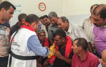 Tunisian fishermen try on life jackets offered by MSF at the end of the training. The fishermen say in general they lack the equipment to cope with boatloads of migrants and refugees in distress.