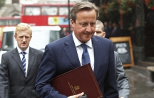Britain's Prime Minister David Cameron walks to Parliament after leaving Number 10 Downing Street in London on September 1, 2014. Cameron announced new laws on Monday to try to stop radicalized Britons returning from Syria and Iraq launching attacks on Br