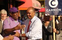 "Adolfo Carrión campaigns along 116th Street in ""El Barrio"" in East Harlem. Carrión, a former Bronx Borough President and member of the Obama administration, is running for New York City mayor on the Independence Party ticket."
