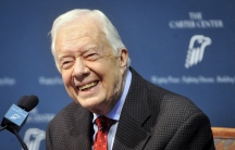 Former President Jimmy Carter takes questions from the media during a news conference about his recent cancer diagnosis and treatment plans, at the Carter Center in Atlanta. Carter, 90, said he will cut back dramatically on his schedule to receive treatme