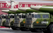 Military vehicles carrying DF-26 ballistic missiles travel past Tiananmen Gate during a military parade to commemorate the 70th anniversary of the end of World War II in Beijing.