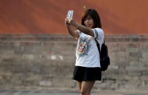 A woman takes a selfie in Beijing, September 2015.