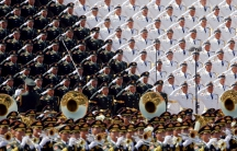 Military band sing and salute at the Tiananmen Square at the beginning of the military parade marking the 70th anniversary of the end of World War II, in Beijing, China, September 3, 2015.