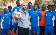 Coach Salvatore Lisciandrello and some of this year's Liberi Nantes players