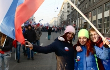 """Faced with western sanctions, the Kremlin has pushed for a renewed sense of patriotism among younger Russians. At the National Unity Day celebrations in Moscow, students sport buttons that read, """"An attack on Russia is an attack on me."""""""