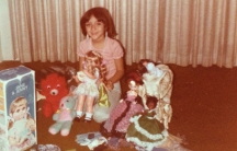 Eight-year-old Susan Cruz enjoying her first Christmas in the United States in 1978.