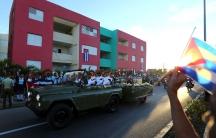 People watch the cortege carrying the ashes of Fidel Castro drive toward Santa Ifigenia cemetery in Santiago de Cuba.