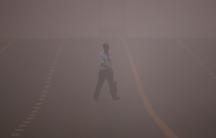 a man crosses a road in New Delhi, India