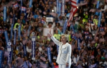 Hillary Clinton waves as she arrives onstage to accept the nomination.