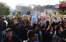 """A student-led protest marches to Istanbul University's Faculty of Arts and Sciences with a banner that reads, """"Through the imagination to the Power"""" and """"From Campus to Kobane""""."""