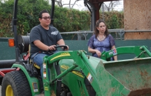 Jessica Fernandes heads the agriculture program at Buena Park High School. Students can learn everything from ag economics to how how to drive a tractor, like sophomore Moses Nathan Talavera.
