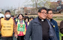 Catholic priests lead a protest march at an anti-nuclear demonstration outside of Seoul in April 2017.