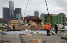 Construction is seen on a new housing development along the riverfront in Detroit, Michigan, December 9, 2015. A year after the city exited the biggest-ever US municipal bankruptcy, a plan to demolish half of its nearly 80,000 blighted or deteriorating st