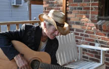 Doug Seegers on the porch of his house.