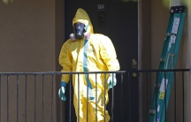 A worker wearing a hazardous material suit arrives at the apartment unit where a man diagnosed with the Ebola virus was staying in Dallas, Texas, on October 3, 2014.