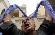 A relative of one of the victims reacts after a church explosion in Tanta, Egypt.