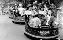 Fatty Arbuckle (center) riding in The Whip, one of William F. Mangels' classic rides. At one time, Mangels had 500 of them in operation.
