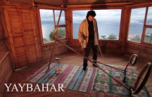 Görkem Şen plays the Yaybahar with the Marmara Sea in the background. He hopes his instrument will soon be as common as a violin or cello.