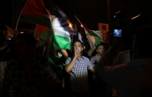 A young Palestinian man chants against Israel's offensive in the Gaza Strip as he marches from Ramallah toward the Israeli settlement and military base at Beit El.
