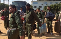 The soldiers arrive at the military airport in Tripoli on Tuesday morning.
