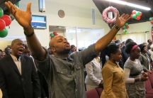 A Sunday service at the Redeemed Christian Church of God in Melrose, Mass. includes gospel singing, a live band, and dancing.