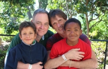 Kevin Fisher-Paulson with his husband Brian and his sons Zane (right) and Aiden.