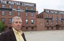 Frank Liebl, executive director of the Newton Development Corporation, in front of the old Maytag headquarters. Community leaders are working to rent out the space, where 2,000 people once worked.