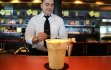 George makes about a hundred frappuccinos a day for the guests on board a Greek ferry docked in Tobruk, Libya.