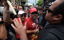 Anti-Trump protesters (R) clash with Donald Trump supporters (L) outside the Anaheim Convention Center during a rally for Republican presidential candidate Donald Trump on May 25, 2016 in Anaheim, California.