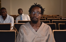 Equatorial Guinean illustrator and comics artist Ramon Nse Esono Ebale looks on in court in Malabo, Equatorial Guinea, on Feb 27, 2018.  The prosecutor of Equatorial Guinea dropped all charges against Ebale because of 'lack of evidence'.