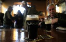 Customers enjoy a pint of stout during Arthur's Day in Dublin.