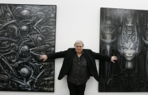 HR Giger poses with two of his works at his museum in Chur, Switzerland. Photograph: Arno Balzarini/AP