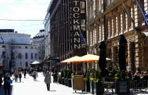 People walk past Stockmann shopping center in Helsinki, Finland, on May 6, 2017.