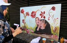 A Beirut artist participates in an event staged by a municipality controlled by Hezbollah to honor those killed in a wave of car bombings in Lebanon.