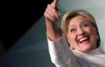 Hillary Clinton pointing towards an audience.