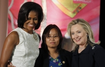 Zin Mar Aung of Myanmar (center) receives congratulations from First Lady Michelle Obama and U.S. Secretary of State Hillary Clinton as she receives a State Department 2012 International Women of Courage Award.