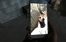 A photo of Jose Lopez Ramirez, 17 shows on a smartphone.