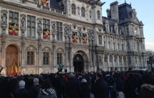 Parisians observe a moment of silence in front of City Hall in honor of the Belgian victims and their own.