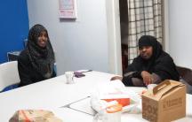 Young Somali women gather at the Somali Development Center in Boston for a healthcare seminar.