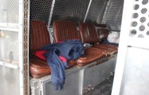 The inside of a private prison transport van.