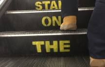 "The words, ""Stand on the right,"" painted into an escalator in London."